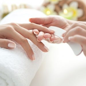 Close up of beautiful female hands having manicure treatment.See more MANICURE and SPA images. Click on image below for lightbox.